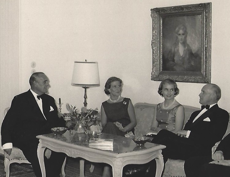 From Left: Ambassador Oscar Schlitter, Daisy Schlitter , Marion von Cramm and Burghard von Cramm under portrait of Daisy D'Ora, in German Embassy