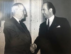 President Harry S. Truman shaking hands with Elias Demetracopoulos